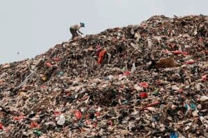 person standing in a landfill