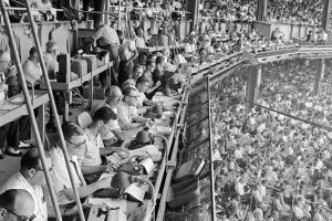 black and white image of a crowded sports stadium