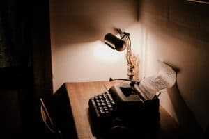typewriter and lamp on a desk
