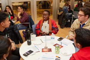 students in conversation around a table