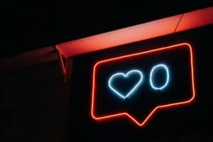 neon sign of a like button with zero likes