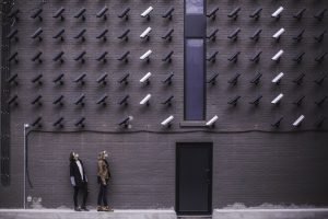 security cameras facing two people