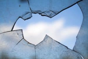 broken glass with a blue sky in the background
