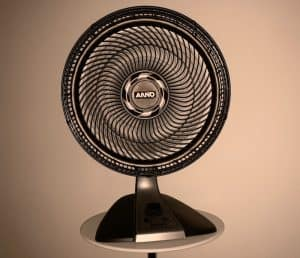 grey fan on a small table