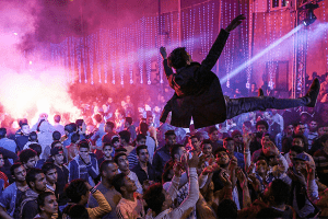 Youth dance at a local wedding in Salam City, a suburb on the outskirts of Cairo.