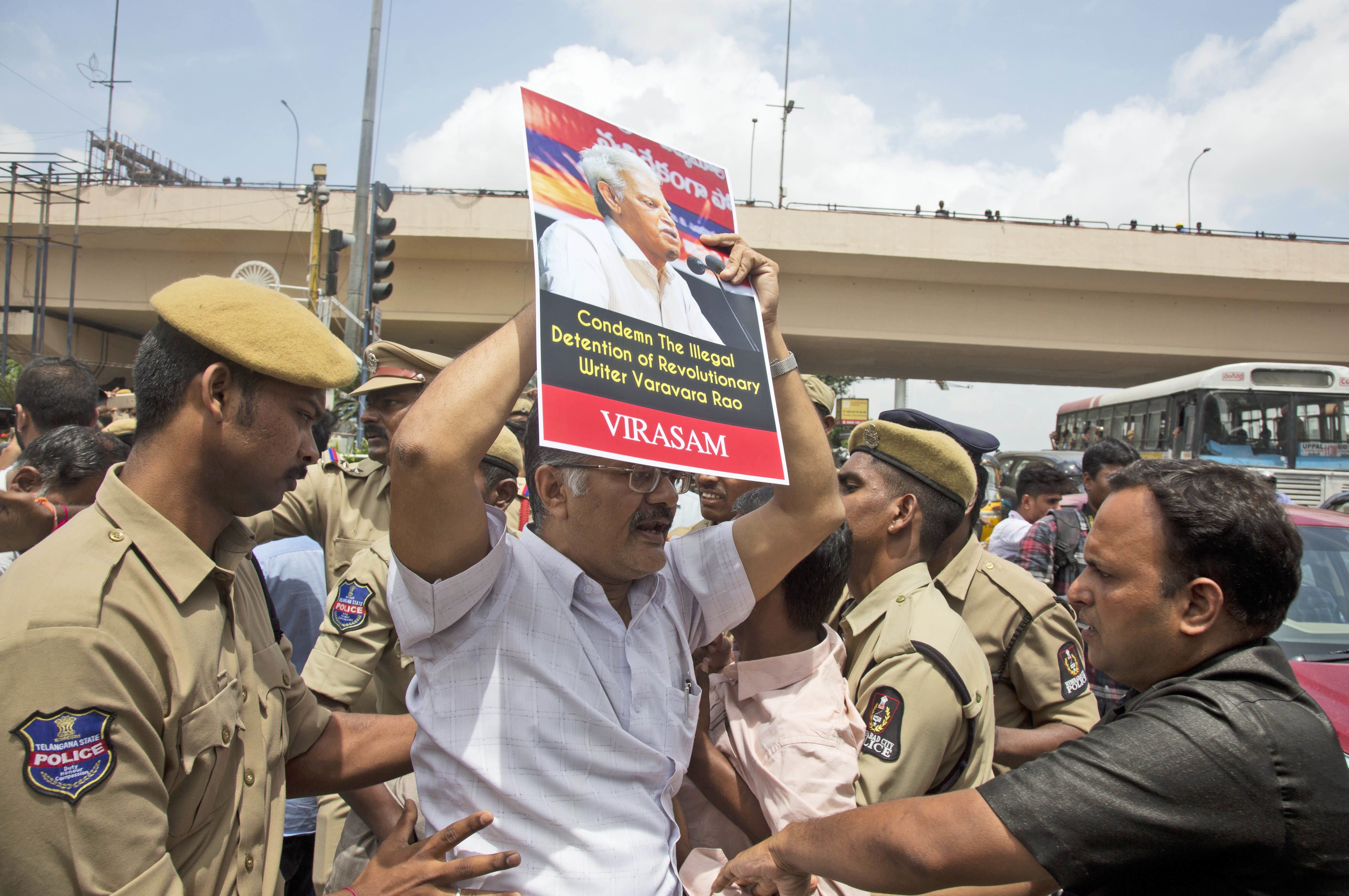 Police in Hyderabad, India detain a protester