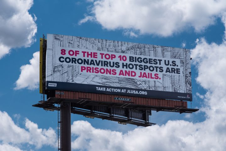 """Billboard that reads: """"8 of the top 10 biggest U.S. coronavirus hotspots are prisons and jails."""""""