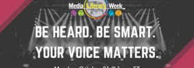 """""""Be Heard. Be Smart. Your Voice Matters."""" Media Literacy Week image, black and magenta with spotlights in background"""